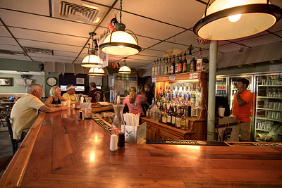 People enjoy great food inside Whaley's Store, a locally owned restaurant located in a former gas station building, in Edisto Beach, SC on Friday, August 29, 2014. Copyright 2014 Jason Barnette