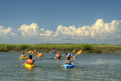 A group of people embark on a kayaking adventure across Big Bay Creek in Edisto Beach, SC on Friday, August 29, 2014. Copyright 2014 Jason Barnette