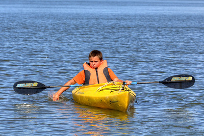 A young boy paddles down Big Bay Creek in Edisto Beach, SC on Friday, August 29, 2014. Copyright 2014 Jason Barnette