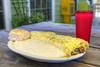 A mammoth and delicious Big John's Omelette at The SeaCow Eatery, a locally owned restaurant, in Edisto Beach, SC on Friday, August 29, 2014. Copyright 2014 Jason Barnette