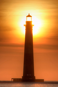 The brilliant morning sun shines through the top of the nonfunctinal Morirs Island Lighthouse in Folly Beach, SC on Tuesday, June 14, 2016. Copyright 2016 Jason Barnette