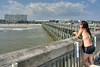A woman spends her last day of vacation fishing on the Edwin S. Taylor Fishing Pier in Folly Beach, SC on Sunday, September 8, 2013. Copyright 2013 Jason Barnette