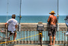 A pair of men fish off the Folly Beach Edwin S. Taylor Pier in Folly Beach, SC on Wednesday, July 4, 2012. Copyright 2012 Jason Barnette