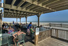 People enjoy the outdoor seating at Locklear's on the Edwin S. Taylor Fishing Pier in Folly Beach, SC on Sunday, September 8, 2013. Copyright 2013 Jason Barnette