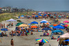 Hundreds of people crowd the beach near the Folly Beach Edwin S. Taylor Pier in Folly Beach, SC on Wednesday, July 4, 2012. Copyright 2012 Jason Barnette