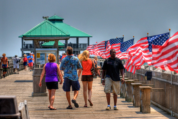 Flags decorate the pier for the Fourth of July holiday at the Folly Beach Edwin S. Taylor Pier in Folly Beach, SC on Wednesday, July 4, 2012. Copyright 2012 Jason Barnette