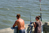 People enjoy fishing on the Edwin S. Taylor Fishing Pier in Folly Beach, SC on Sunday, September 8, 2013. Copyright 2013 Jason Barnette