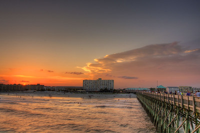 A warm sunset looking across the ocean and beach from the end of the Edwin S. Taylor Fishing Pier in Folly Beach, SC on Monday, July 7, 2014. Copyright 2014 Jason Barnette