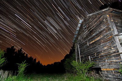 Star trails streak over an old tobacco barn in Galivants Ferry, SC on Monday, March 26, 2012. Copyright 2012 Jason Barnette  SPECIAL DONATION TO THE INTERNATIONAL DARK-SKY ASSOCIATION: I will donate 20% of all print sales of this photo to the International Dark-Sky Association to help with their fight to preserve the night!
