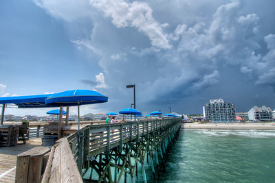 A summer thunderstorm approaches the fishing pier in Garden City Beach, SC on Thursday, June 2, 2016. Copyright 2016 Jason Barnette