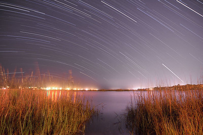 Star trails streak across the sky over the marshes in Garden City Beach, SC on Tuesday, April 9, 2013. Copyright 2013 Jason Barnette   SPECIAL DONATION TO THE INTERNATIONAL DARK-SKY ASSOCIATION: I will donate 20% of all print sales of this photo to the International Dark-Sky Association to help with their fight to preserve the night!