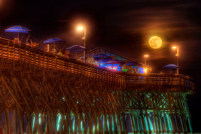 The full moon rises over the Garden City Beach Pier in Garden City Beach, SC on Monday, June 4, 2012. Copyright 2012 Jason Barnette