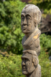 One of the towering totem poles carved by artist Roy Smith, on display on the Marshwalk in Georgetown, SC on Tuesday, September 2, 2014. Copyright 2014 Jason Barnette