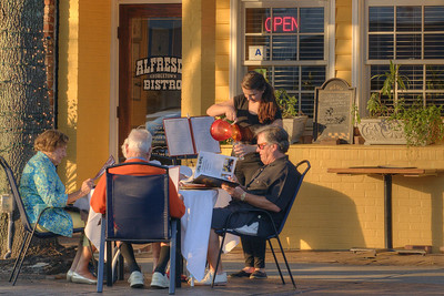 People dine outside on the sidewalks at Alfresco Bistro in historic downtown Georgetown, SC on Friday, September 6, 2013. Copyright 2013 Jason Barnette