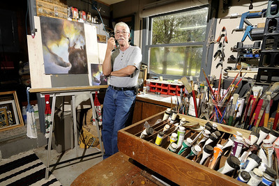 Artist Roy Smith poses in his painting area inside his home workshop in Georgetown, SC on Tuesday, September 2, 2014. Copyright 2014 Jason Barnette