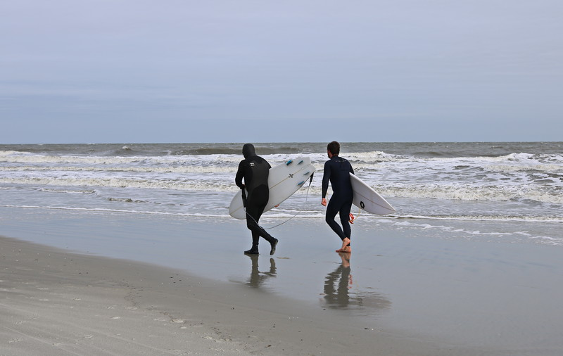 Wetsuits and Surfboards at the Beach