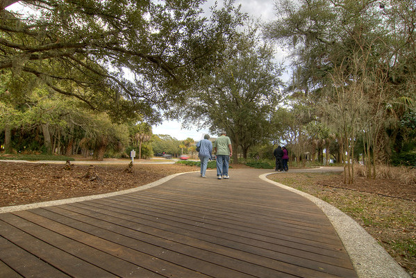 Couple walk along a beautiful sidewalk in Hilton Head Island, SC on Sunday, February 22, 2015. Copyright 2015 Jason Barnette