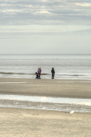 A family enjoys a walk on the beach during a warm winter day in Hilton Head Island, SC on Sunday, February 22, 2015. Copyright 2015 Jason Barnette