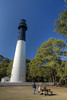 A family enjoys a warm early spring day with a view of the Hunting Island Lighthouse at Hunting Island State Park in Hunting Island, SC on Friday, February 20, 2015. Copyright 2015 Jason Barnette  Completed in 1875, the 133' lighthouse is one of only two segmented cast iron lighthouses in the country. The segments are made of cast iron, lined with brick, and intended to be moved if necessary. In 1888 the lighthouse and keeper's house was moved a mile inland to its current location.   Today visitors can climb the 167 steps to the circular observation platform 110' high for spectacular views of the local coastal landscapes.
