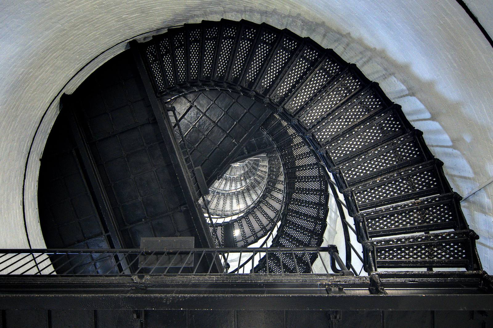 A view of the spiraling cast and wrought iron staircase inside the Hunting Island Lighthouse at Hunting Island State Park in Hunting Island, SC on Friday, February 20, 2015. Copyright 2015 Jason Barnette Completed in 1875, the 133' lighthouse is one of only two segmented cast iron lighthouses in the country. The segments are made of cast iron, lined with brick, and intended to be moved if necessary. In 1888 the lighthouse and keeper's house was moved a mile inland to its current location. Today visitors can climb the 167 steps to the circular observation platform 110' high for spectacular views of the local coastal landscapes.