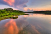 A colorful sunset across the lake at Huntington Beach State Park in Murrells Inlet, SC on Friday, May 13, 2016. Copyright 2016 Jason Barnette