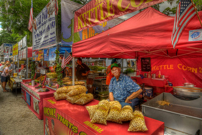 Vendors set up booths for food at The 31st Annual Blue Crab Festival on the historic waterfront in Little River, SC on Sunday, May 20, 2012. Copyright 2012 Jason Barnette