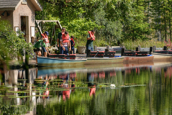 A group of people climb into boats for a tour of the marshes at Cypress Gardens in Moncks Corner, SC on Saturday, September 7, 2013. Copyright 2013 Jason Barnette