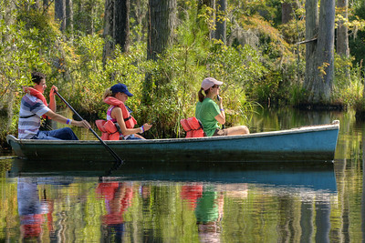 A tour guide leads a couple across the marshes at Cypress Gardens in Moncks Corner, SC on Saturday, September 7, 2013. Copyright 2013 Jason Barnette