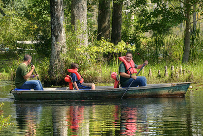 A family tours the marshes in a boat at Cypress Gardens in Moncks Corner, SC on Saturday, September 7, 2013. Copyright 2013 Jason Barnette