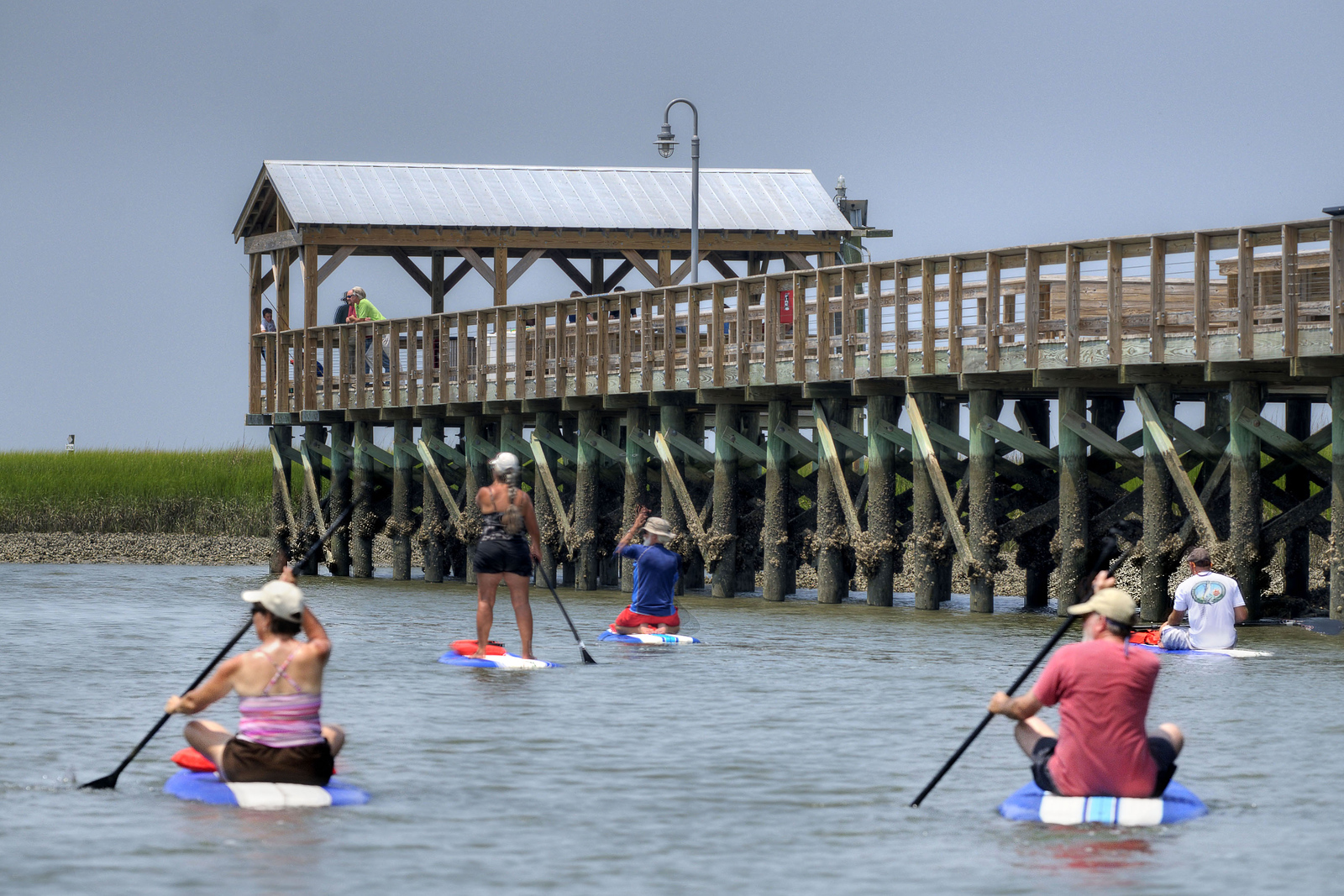 Paddleboarders head out along the creek at the Shem Creek Park & Boardwalk in Mt. Pleasant, SC on Wednesday, July 9, 2014. Copyright 2014 Jason Barnette