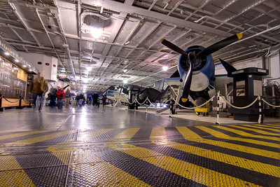 People explore the aircraft on the Hangar Deck on the USS Yorktown CV-10 at the Patriots Point Naval Maritime Museum in Mt. Pleasant, SC on Saturday, February 28, 2015. Copyright 2015 Jason Barnette  Patriots Point is a popular tourist attraction located along the Cooper River. The site serves as the home of the USS Yorktown aircraft carrier, USS Clamagore submarine, and USS Laffey destroyer. The museum also features a gift shop, the Vietnam War Experience, and boat tours to Fort Sumter.