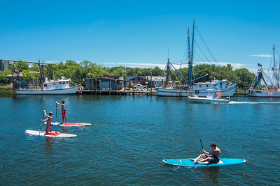 Paddleboarders enjoy the view along the Shem Creek Boardwalk in Mount Pleasant, SC on Friday, May 27, 2016. Copyright 2016 Jason Barnette