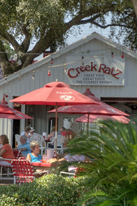 People enjoy outdoor dining at Creek Ratz in Murrells Inlet, SC on Tuesday, September 10, 2013. Copyright 2013 Jason Barnette