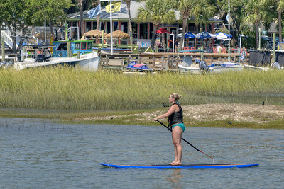 A woman paddleboards along the inlet near Goat Island in Murrells Inlet, SC on Tuesday, September 10, 2013. Copyright 2013 Jason Barnette