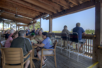 People eat lunch on the covered outdoor patio with a view of the inlet along the Marshwalk at Drunkin' Jacks in Murrells Inlet, SC on Tuesday, September 10, 2013. Copyright 2013 Jason Barnette