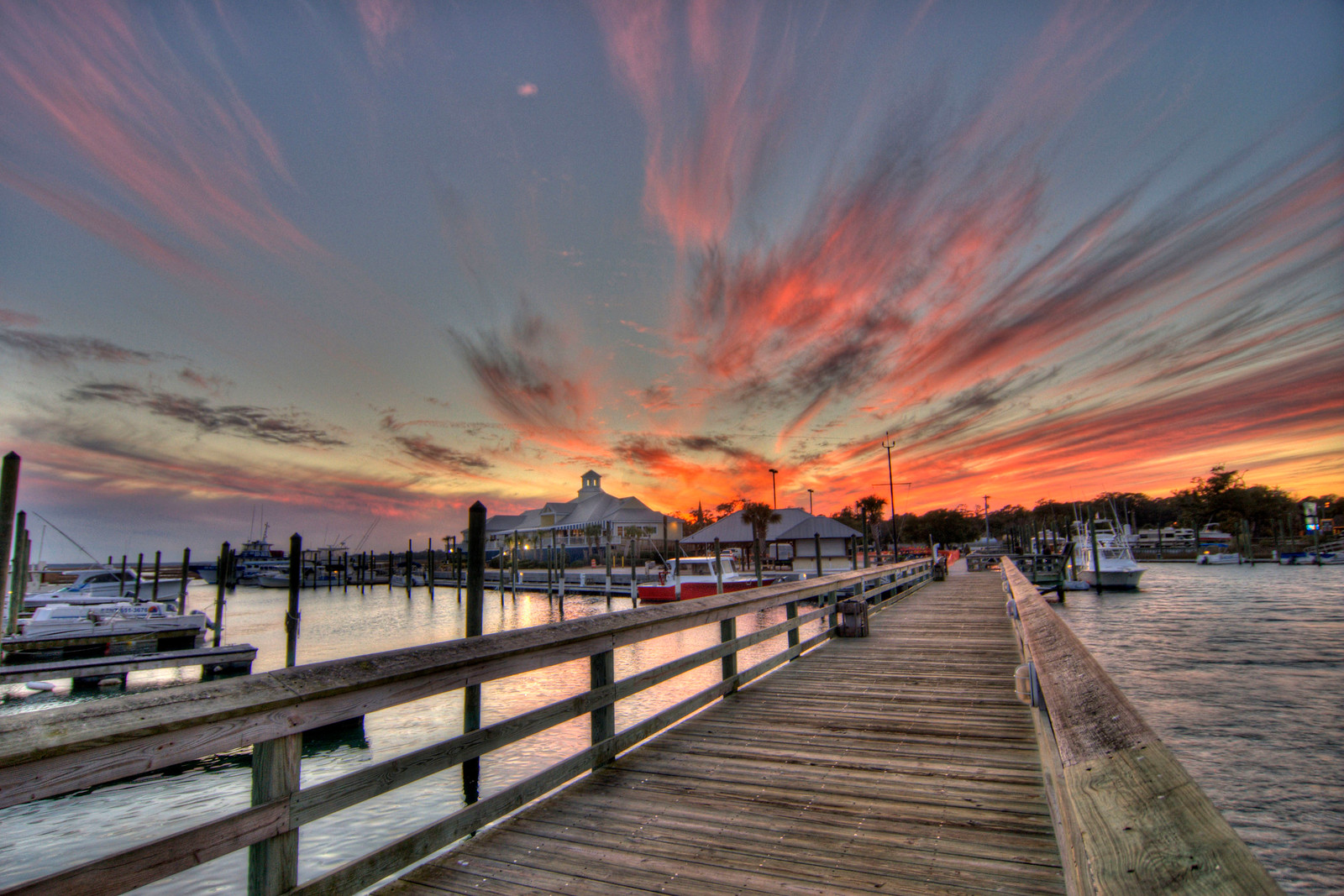 A dramatic sunset along The Marshwalk in Murrells Inlet, SC on Monday, January 7, 2013. Copyright 2013 Jason Barnette