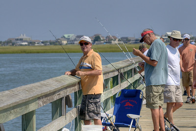 A group of men fish off the pier on the Marshwalk in Murrells Inlet, SC on Tuesday, September 10, 2013. Copyright 2013 Jason Barnette