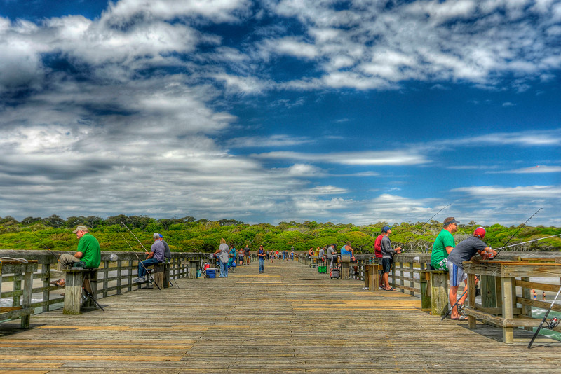 People enjoy fishing on the pier in Myrtle Beach State Park in Myrtle Beach, SC on Saturday, April 14, 2012. Copyright 2012 Jason Barnette