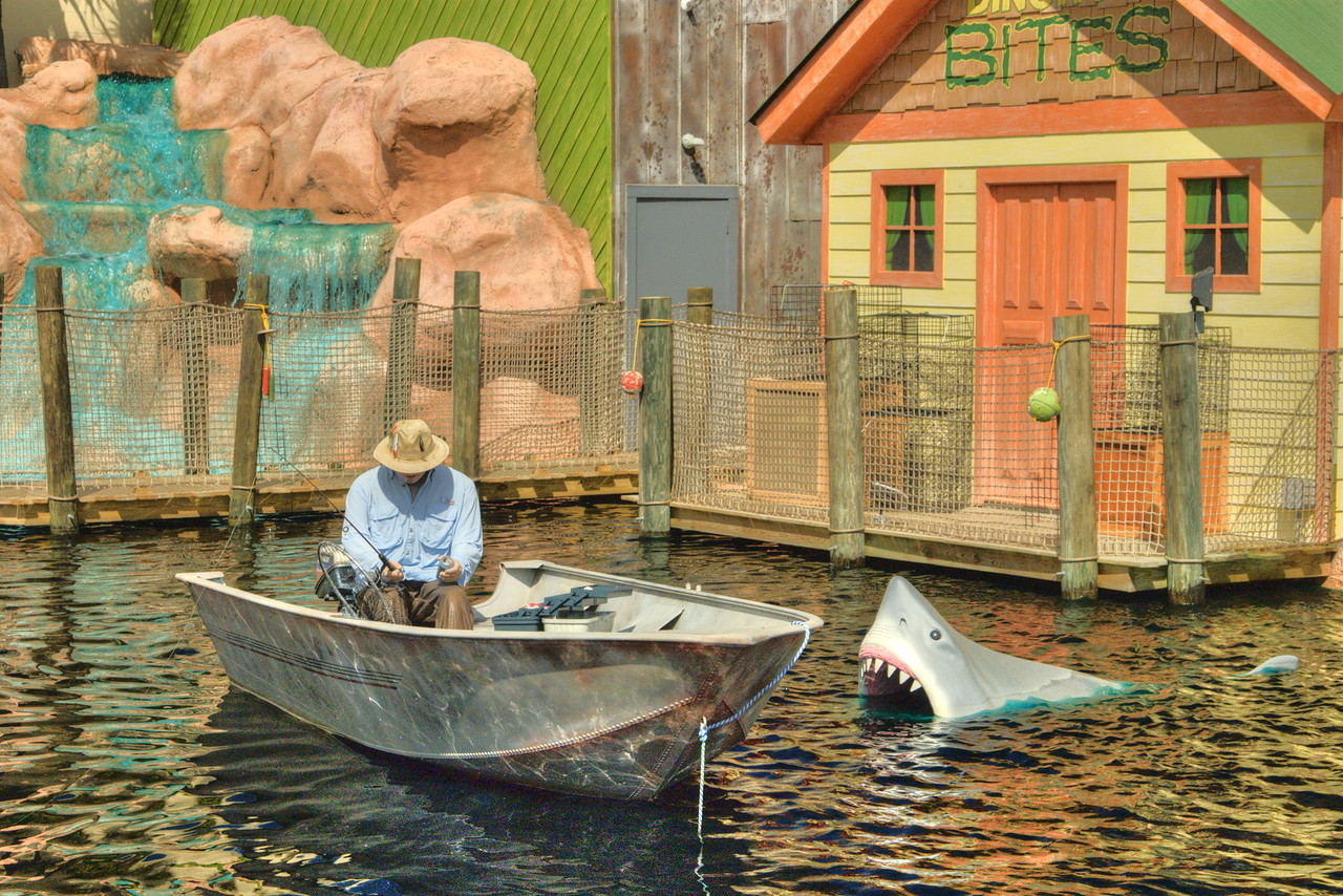 An enormous great white shark will periodically jump from the water to attack the faux fisherman in the pond at the Shark Attack Adventure Golf in Myrtle Beach, SC on Wednesday, May 8, 2013. Copyright 2013 Jason Barnette