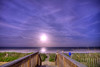 The Supermoon, a celestial event when the full moon coincides with its closest approach to the Earth, rises over the ocean near the Myrtle Beach Boardwalk in Myrtle Beach, SC on Sunday, June 23, 2013. Copyright 2013 Jason Barnette