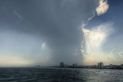 A powerful summer thunderstorm towers over Myrtle Beach, seen from the Cherry Grove Fishing Pier in North Myrtle Beach, SC on Friday, June 26, 2015. Copyright 2015 Jason Barnette