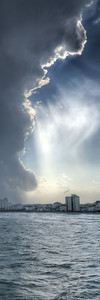 Sunlight beams from the edge of a towering summer thunderstorm near the Cherry Grove Fishing Pier in North Myrtle Beach, SC on Friday, June 26, 2015. Copyright 2015 Jason Barnette