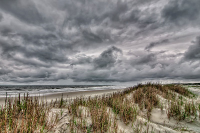 Storm clouds from Tropical Storm Bonnie linger over the south end public beach access at Pawley's Island, SC on Sunday, May 29, 2016. Copyright 2016 Jason Barnette