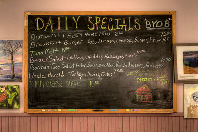 The daily specials are written on a chalkboard inside of Mikki's Schoolhouse Diner in Port Royal, SC on Saturday, February 21, 2015. Copyright 2015 Jason Barnette  Mikki's Schoolhouse Diner is a locally owned restaurant located inside an old one-room schoolhouse. The schoolhouse was moved to it's current location in a small shopping village in Port Royal from nearby Yemassee. The restaurant is owned and operated by Mikki and Jeff Rolaine, along with Jeff's daughter Arastatia, making it a truly family operated business.