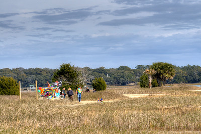 Dozens of people enjoy a warm winter day at the Sands Beach in Port Royal, SC on Saturday, February 21, 2015. Copyright 2015 Jason Barnette