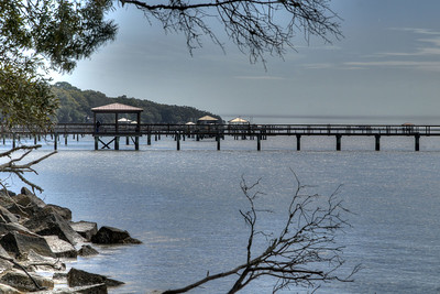 View of nearby private boat docks from the beach at Fort Fremont Historical Park in Saint Helena Island, SC on Sunday, February 22, 2015. Copyright 2015 Jason Barnette  Fort Fremont consists of several concrete artillery batteries built 1898 in response to the Spanish-American War. The fort was intended to defend local Naval Station Port Royal from invading ships during the war. The fort was deactivated in 1921. Over the next eight decades the property switched hands between several private owners until 2004 when the Trust for Public Land and Beaufort County Council bought the property.   Today the property is open to the public to explore the ruins of the concrete batteries. The area is only lightly maintained, and visitors enter at their own risk. However, it is a rare and thrilling place to explore.