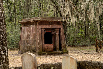 A small mausoleum at the Chapel of Ease Ruins in Saint Helena Island, SC on Sunday, February 22, 2015. Copyright 2015 Jason Barnette  The chapel was building in the mid-1700's to serve the families of plantation owners on Saint Helena Island. In 1886 a forest fire destroyed the church, leaving only the walls and a single pillar standing.   Today the grounds are maintained by Parish Church of St. Helena. The ruins are open to the public 24/7 for respectful exploration, and permits can be acquired for photo shoots and weddings.