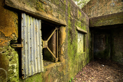 Old metal shudders still in place at Fort Fremont Historical Park in Saint Helena Island, SC on Saturday, February 21, 2015. Copyright 2015 Jason Barnette  Fort Fremont consists of several concrete artillery batteries built 1898 in response to the Spanish-American War. The fort was intended to defend local Naval Station Port Royal from invading ships during the war. The fort was deactivated in 1921. Over the next eight decades the property switched hands between several private owners until 2004 when the Trust for Public Land and Beaufort County Council bought the property.   Today the property is open to the public to explore the ruins of the concrete batteries. The area is only lightly maintained, and visitors enter at their own risk. However, it is a rare and thrilling place to explore.