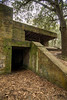 A darkened entryway into the bowels of the structure at Fort Fremont Historical Park in Saint Helena Island, SC on Saturday, February 21, 2015. Copyright 2015 Jason Barnette  Fort Fremont consists of several concrete artillery batteries built 1898 in response to the Spanish-American War. The fort was intended to defend local Naval Station Port Royal from invading ships during the war. The fort was deactivated in 1921. Over the next eight decades the property switched hands between several private owners until 2004 when the Trust for Public Land and Beaufort County Council bought the property.   Today the property is open to the public to explore the ruins of the concrete batteries. The area is only lightly maintained, and visitors enter at their own risk. However, it is a rare and thrilling place to explore.