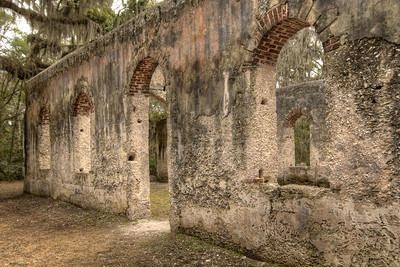 The Chapel of Ease Ruins in Saint Helena Island, SC on Sunday, February 22, 2015. Copyright 2015 Jason Barnette  The chapel was building in the mid-1700's to serve the families of plantation owners on Saint Helena Island. In 1886 a forest fire destroyed the church, leaving only the walls and a single pillar standing.   Today the grounds are maintained by Parish Church of St. Helena. The ruins are open to the public 24/7 for respectful exploration, and permits can be acquired for photo shoots and weddings.